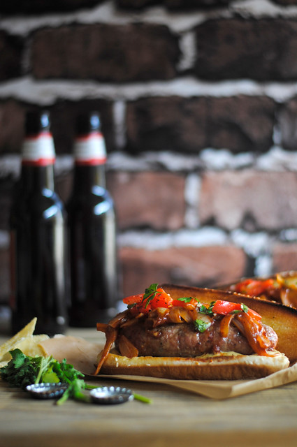 Grilled Sausage Sandwich with Onion Sauce and Grilled Red Pepper Relish