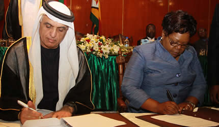 Republic of Zimbabwe Vice President Joice Mujuru with Ras al Khaimar leader Sheikh Saud signing a memorandum of understanding. The Sheikh spent several days in Zimbabwe. by Pan-African News Wire File Photos