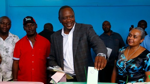 Uhuru Kenyatta casting vote in Kenyan national elections. Kenyatta has accused Britain of interfering in the elections. by Pan-African News Wire File Photos