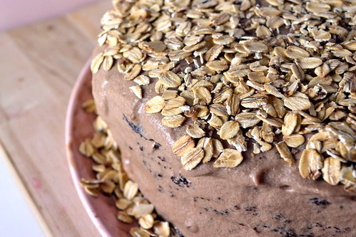 mocha cake topped with mocha frosting and toasted oats