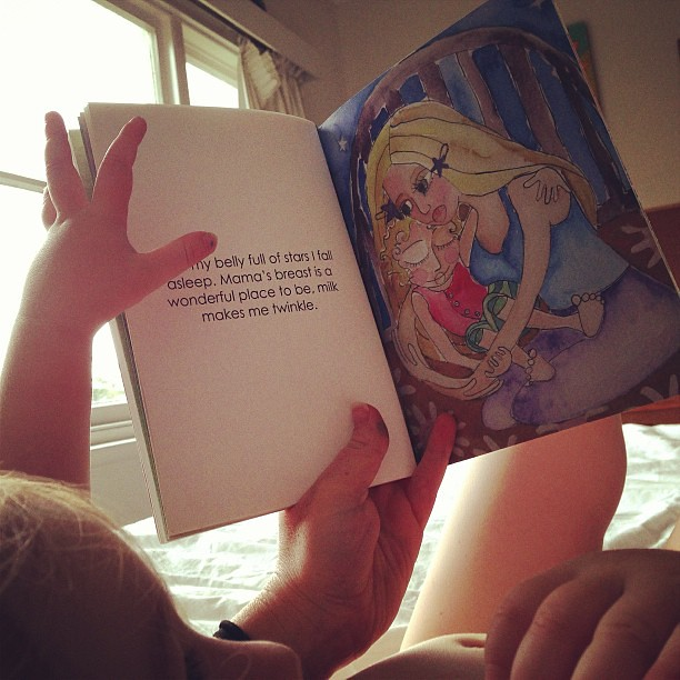 She loves the ending best of all #bellyfullofstars #thewonderfulplace #toddlerbreastfeeding @spiralgarden
