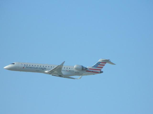 American Eagle jet N507AE displaying her brand new livery soars into the skies above LAX