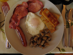 Full Irish breakfast of mushrooms, sausage, gammon, eggs, and potato in our Ballycastle B&B, Ireland, UK
