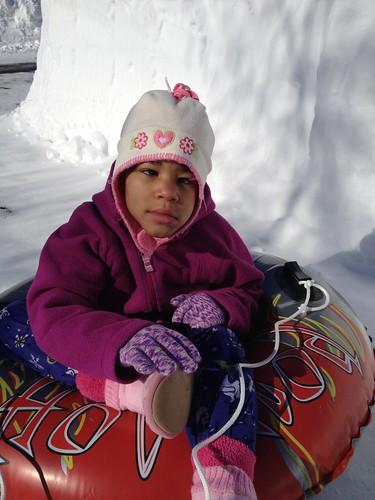 Siraya sitting on snow tube