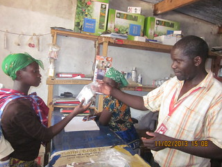 Alfred Siachoobe sells a Kit Yamoyo