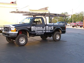 Company Pickup Truck With Heavy-Duty Truck Bed Cover & Ladder Rack