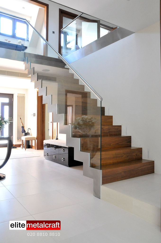 Modern Staircase Constructed From Steel, Glass, Marble And Hardwood Timber