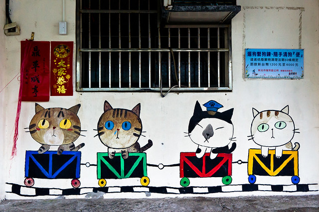 Mural of cats in mining cars