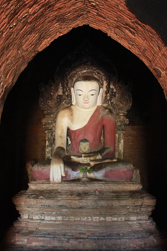 The small Buddha was the original in this stupa. A larger Buddha was later built around the smaller Buddha, making the smaller Buddha appear to be a baby.