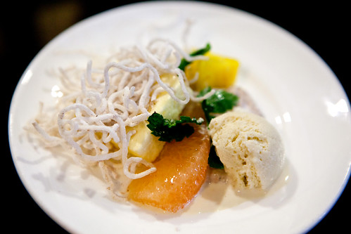 Yuzu Chiboust with coconut rice pudding, caraway ice cream, grapefruit segment, diced pineapple, fried spiced rice noodles