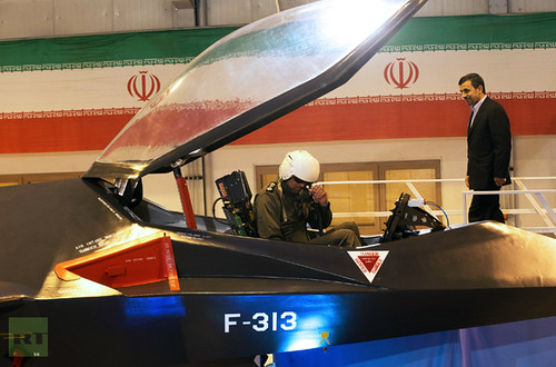 Iranian President Mahmoud Ahmadinejad inspects the new fighter jet produced by the Islamic Republic. The 1979 Revolution has produced tremendous gains for the Middle East nation. by Pan-African News Wire File Photos