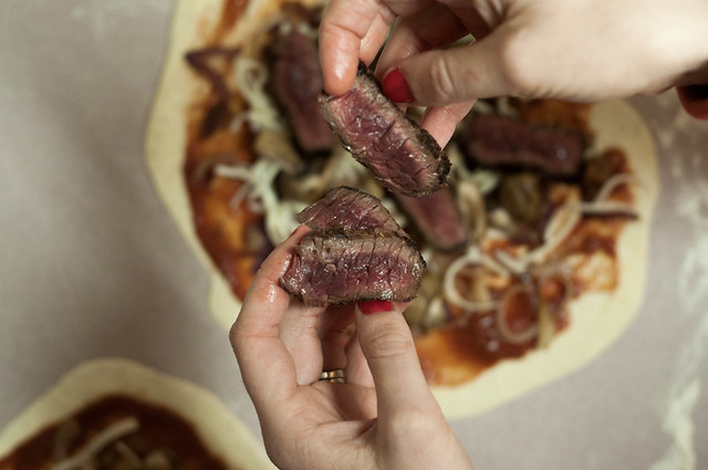 rare caribou steaks, sliced & grilled on pizza