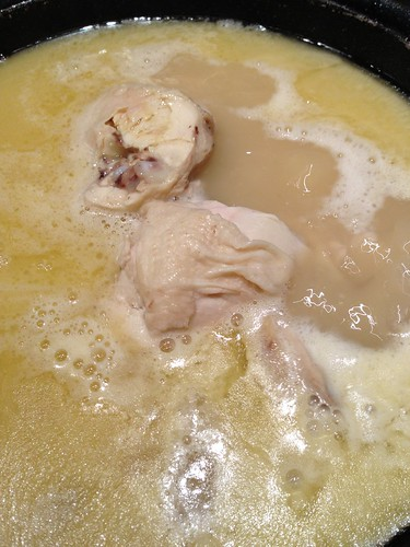 Chicken Chunks within the boiling collagen stock