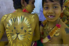 Two boys showing off their body paint during a Pulikali performance (a traditional Indian folk dance) in Umaria, India