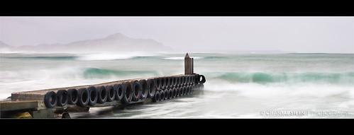 ocean longexposure seascape water rain landscape southafrica coast pier nikon waves tripod calm cliffs slowshutter serene turqoise mistycliffs westerncape d300 1685mm