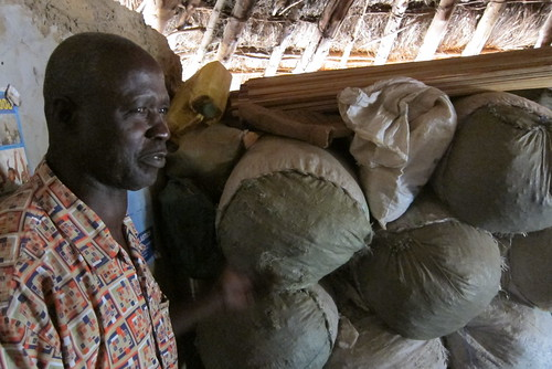 John Julias shows us groundnuts, ready to sell