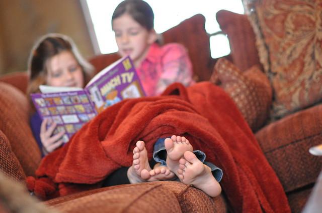 girls reading books, feet