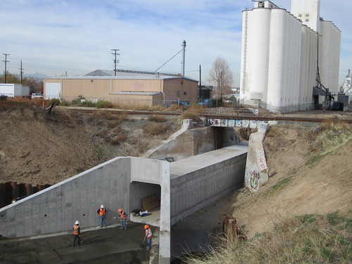 Photo of workers building concrete box culvert for Market Lead commuter rail overpass