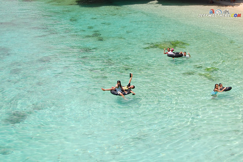 Kids enjoying the crystal clear waters