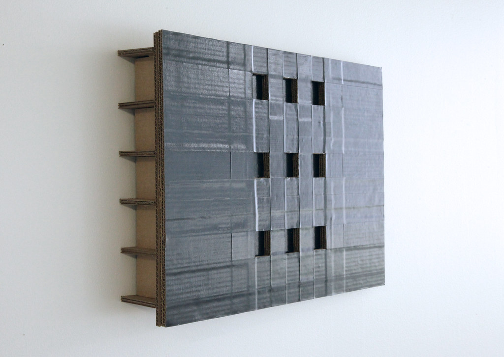 A sculpture made from corrugated cardboard and duct tape.