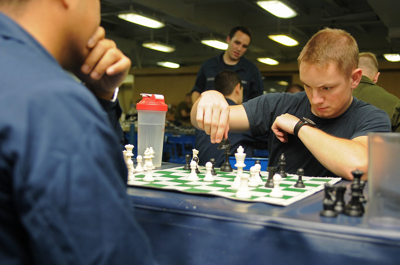 Quartermaster 3rd Class Frank P. Grossmann, (right), competes against Operations Specialist 2nd Class Joel Padin