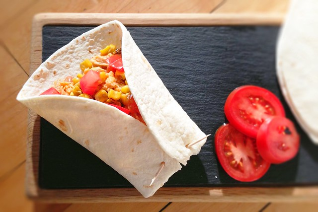 Slow cooker nacho chicken, beans and rice wraps
