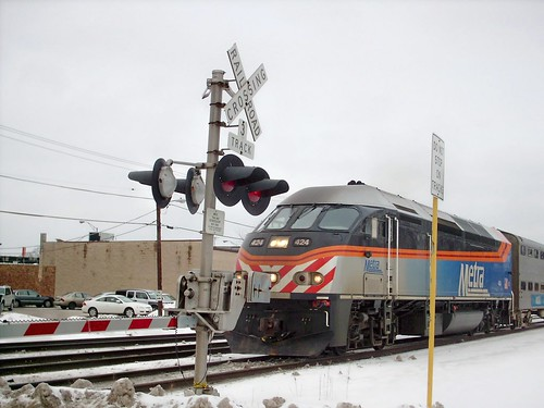 Westbound Metra commuter train approaching the station stop at Elmwood Park Illinois.  February 2008. by Eddie from Chicago