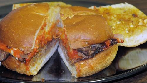 Roast beef parmigiana sandwich and garlic bread by Coyoty