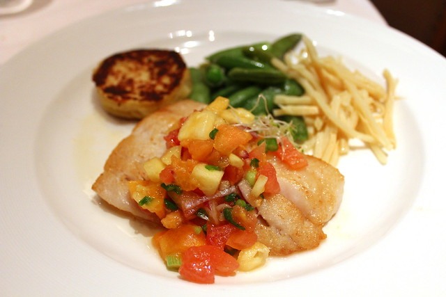 Seared Bass Filet with Pineapple-Papaya Salsa peapods, bamboo shoots, daikon sprouts and potato cake