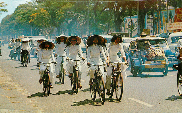 High School Girls on Bicycles - Wearing Ao Dai - 1968 Postcard