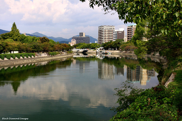 Tranquil Ohta River, Hiroshima Peace Memorial Park (left), The Atomic Bomb Dome, A-Bomb Dome or Genbaku Dome (centre) - Hiroshima, Japan