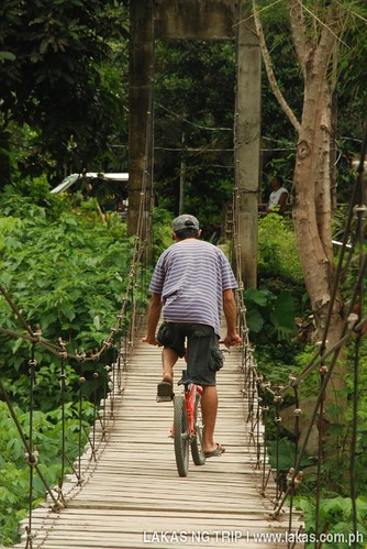 Biking on the hanging bridge at Cabcaben River, Brooke's Point, Palawan