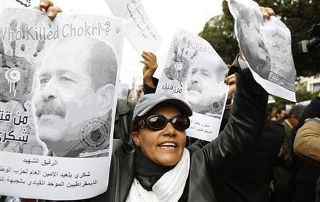 Demonstrators in Tunisia hold posters of Chokri Belaid during nationwide unrest during February 2013. A suspect in the assassination of the opposition figure has been arrested. by Pan-African News Wire File Photos