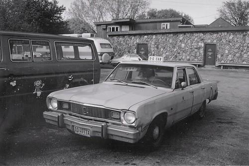An old worn out early 1970's era Chrysler taxi cab.  Lyons Illinois.  May 1989. by Eddie from Chicago