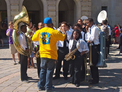 Band director preps his Class Got Brass group before they parade in front of the judges  at Congo Square New World Rhythms Festival 2013. Photo by Melanie Merz.