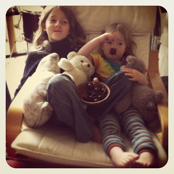 A bowl of cherries, favourite movie and a sister to snuggle #lovethem #sisters
