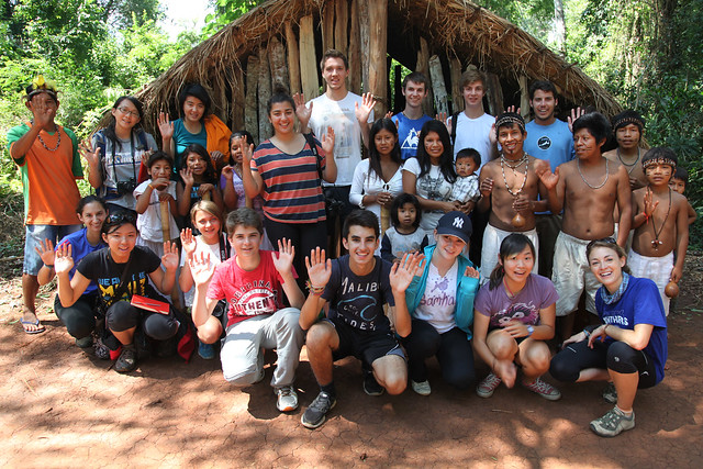 Members of the Guarani tribe lead TGS students in a welcoming hand gesture (Colonia, Argentina)