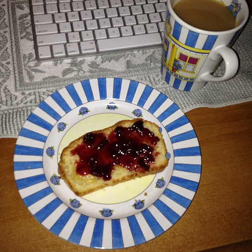Evening snack: Earl Grey and a slice of English muffin bread, toasted and topped with cherry preserves.