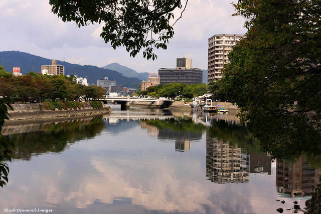 The Tranquil Ohta River, Hiroshima Peace Memorial Park (left), The Atomic Bomb Dome, A-Bomb Dome or Genbaku Dome (centre) - Hiroshima, Japan
