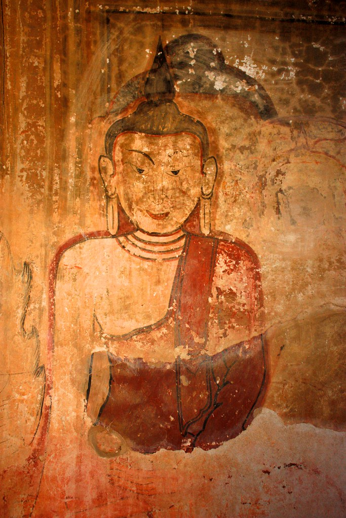 It looks like there was another Buddha on this wall before this more apparent one was painted