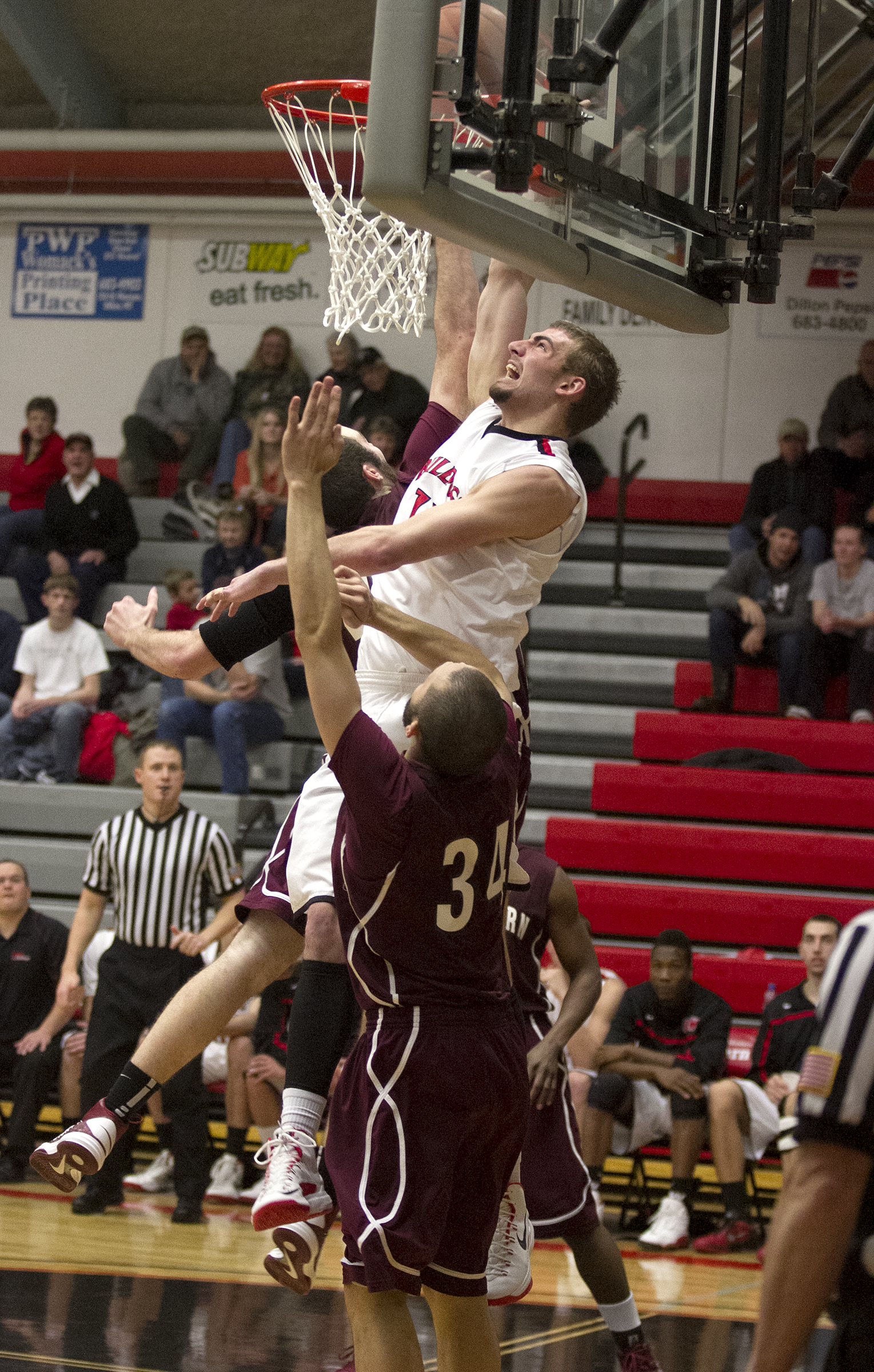 Jake Owsley goes up for a dunk during a men's basketball game