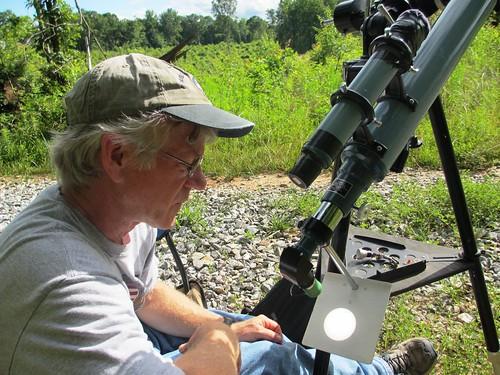Bruce Bellenir, member of the Friends of High Bridge Trail State Park, prepares for an astronomy program