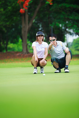 summer vacation people woman man game cute green girl field grass sport club ball golf landscape asian thailand happy person asia play action outdoor background small lawn young lifestyle competition player resort course professional equipment together thai golfing tropical tropic leisure recreation teaching activity putting golfer active caucasian recreational compete