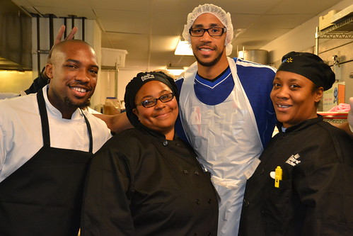 Culinary instructor Rock Harper and students LaJoy Green and Tabitha Peyton flash a smile with Wizards guard Garrett Temple.