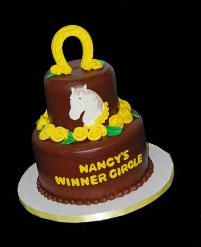 Brown and yellow horse themed cake for a celebration at a race track