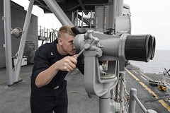 Quartermaster 3rd Class Michael Yale scans for surface contacts aboard USS Boxer (LHD 4) while operating in the South China Sea, Aug. 6. (U.S. Navy/MC3 Brett Anderson)