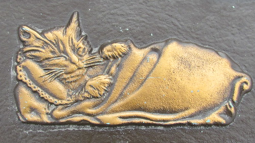 pet cemetery: cat tucked safely in, in Heaven by William Keckler
