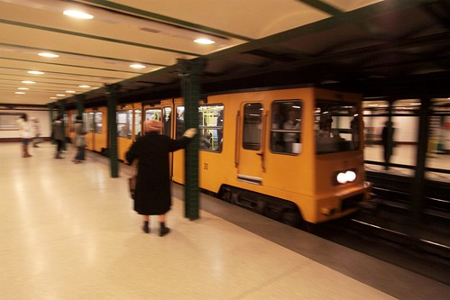 Train arrives into Oktogon station on the 100 year old Budapest Metro