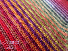 Close-up of the rainbow color range of striped stitching.