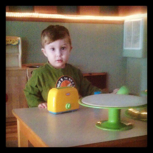 KFP explores a child-sized kitchen in the Orpheum Children's Science Museum in Champaign, IL. #museums